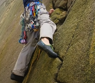 trad climbing by jamming lace climbing shoes in cracks
